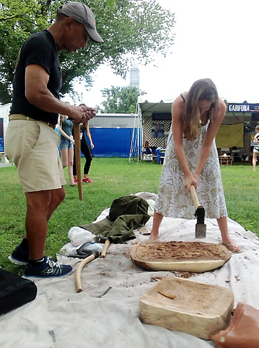<p>Earl Kawa'a demonstrates the creation of a papa ku'i 'ai (poi pounding board) to Smithsonian Folklife Festival visitors. Kawa'a will craft a papa ku'i 'ai  and  ku'i 'ai pohaku (poi pounder) during the festival to donate to the Smithsonian Institution.</p>