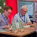 Douglas Hurd and Edward Young sign copies of their book Disraeli |