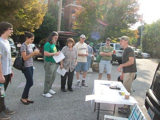 Members listen and learn about the Covington Farmer's Market use of assistance programs.