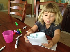 Emily works on a letter to Aunt Rachel and Uncle Mark in Hawaii