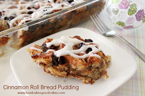 Cinnamon Roll Bread Pudding on white plate with fork.