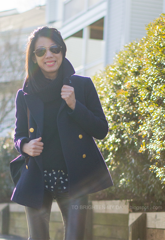 navy peacoat, black turtleneck sweater, navy blouse, black leather pants