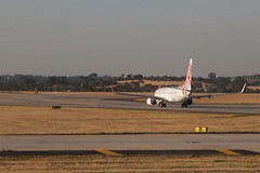 Virgin Australia 737 taxiing towards the runway