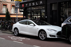 automobile(1.0), tesla(1.0), executive car(1.0), wheel(1.0), vehicle(1.0), performance car(1.0), automotive design(1.0), sedan(1.0), land vehicle(1.0), luxury vehicle(1.0),