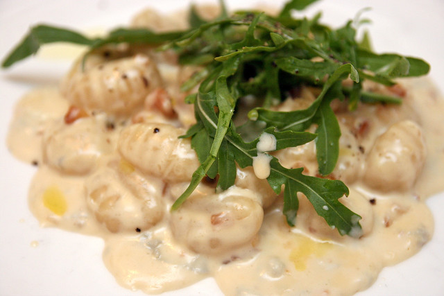 Homemade potato gnocchi, gorgonzola and walnut sauce, fresh rucola