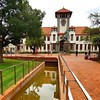 The beautiful campus of the University of the Free State in Bloemfontein. The grass is green after the soaking rains; the sky weighs heavy with the promise of more. It's always good to be in Bloem. It's the heartland. And here on the campus, it's a free s