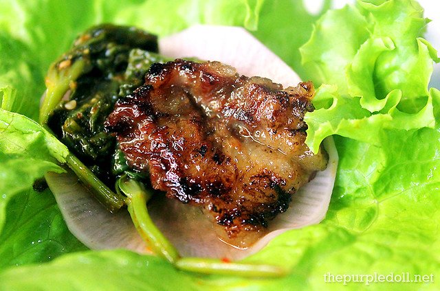 So Galbi wrapped in lettuce with kangkong and pickled radish
