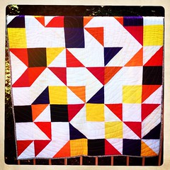 Random HST quilt. First time circle quilting