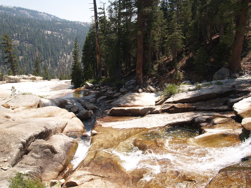 Spiller Creek flowing over smooth granite as it prepares to descend steeply into Virginia Canyon