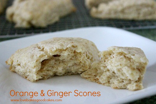 Orange & Ginger Scones pulled a part on white plate.