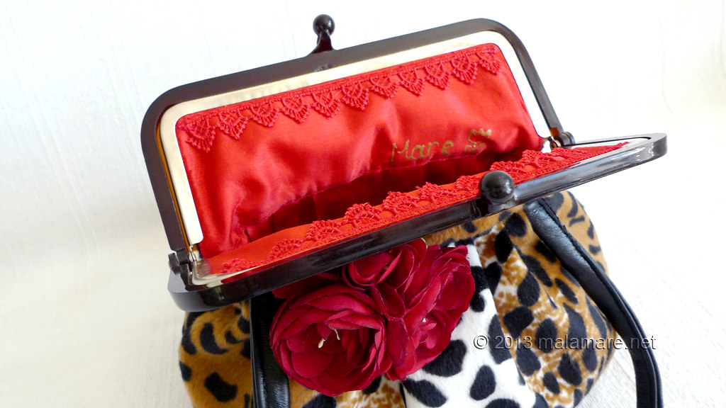 velvet handbag with leopard pattern inside