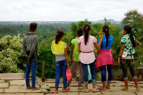Local kids watching the view from Phnom Bakheng temple, Angkor Wat