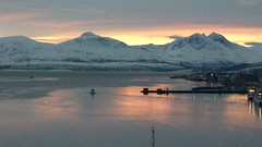 A little boat leaving Tromsø harbour, seen from the bridge to the mainland