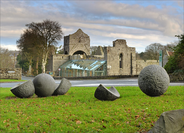 Boyle Abbey with the 'Brothers' sculpture in foreground