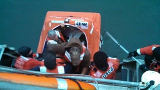 A Station Bodega Bay rescue crew saved three crew members after their fishing vessel sank near Salt Point in Jenner, Calif., March 24, 2014. All three crewmembers were safely transported from the 34-foot fishing vessel Robert Croll via lifeboat after it was determined the dewatering equipment onboard was not keeping up with the flooding. (U.S. Coast Guard photo)