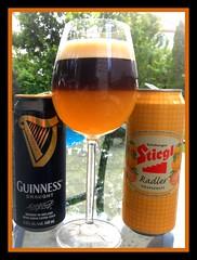 Carefully poured Guinness on top of Stiegl Grapefruit beer ( radler )