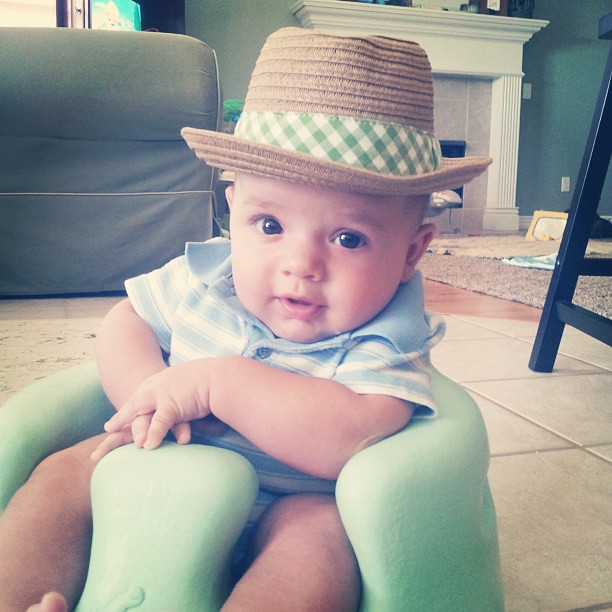 The teether is rockin' the fedora look rather well.