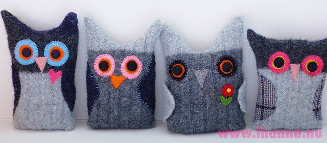 Four recycled sweater owls