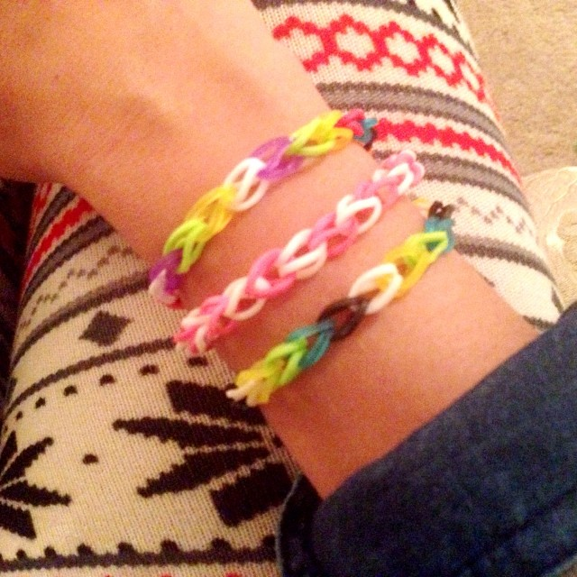 Rainbow loom love. I am so addicted!! Anyone else playing with their kids Christmas gifts? Autumn told me she wants to make bracelets alllll night long!' Oh boy!! She is getting the hang of it and now Nathan wants to try it.