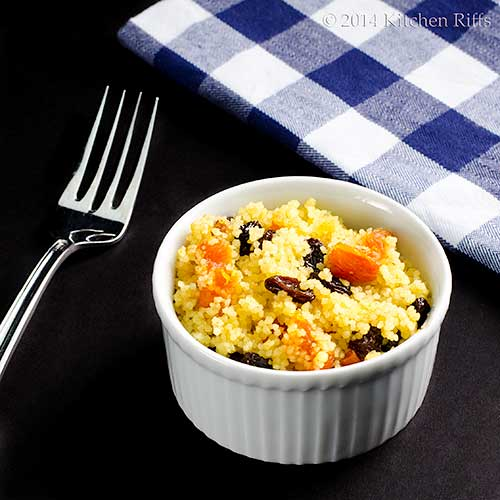 Couscous with Dried Fruit in bowl, fork and napkin in background