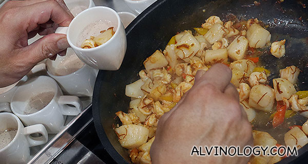 Adding the seafood into the tofu cups