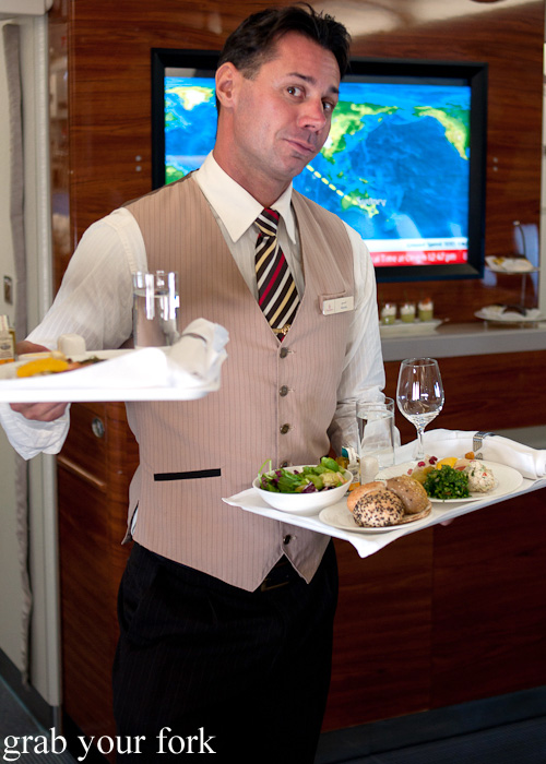 Cabin crew serving Business Class lunches on the Emirates A380