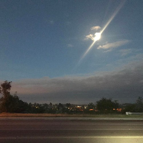 Full moon Thursday on my morning Dawn Patrol 🚴 ride. Not sure why the phone introduced the flare... . . #sandiego #spring #bikeride #dawnpatrol #moon #fullmoon