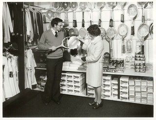 A customer purchasing a tennis racquet from a sports shop in Wellington (Mel Lewis Sports Shop)