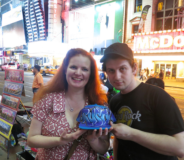 Graffiti Trucker Hat Being Personalized in New York City's Times Square
