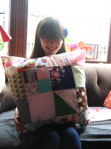 Livvy with her patchwork cushion