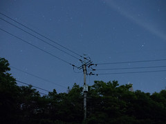 an electric pole and stars