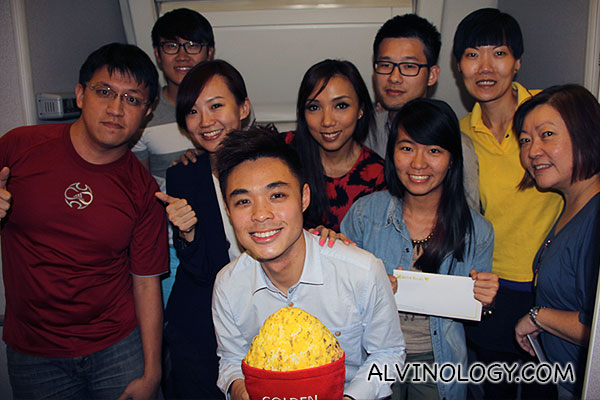 The five happy winners with the two radio deejays and Scoot and GV Movie Club representatives