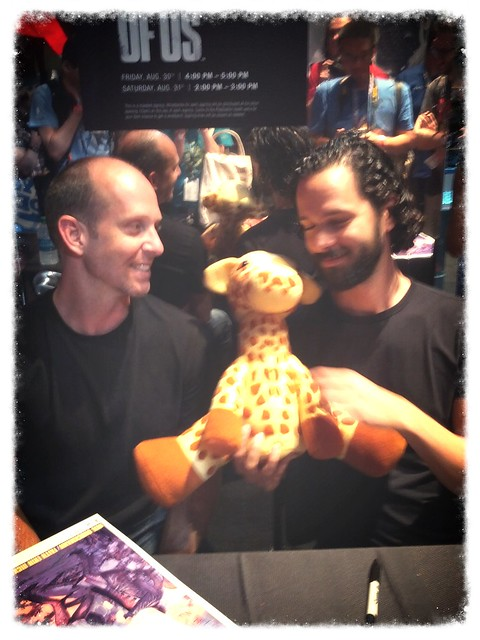 Bruce Straley and Neil Druckmann with the indestructible post apocalyptic giraffe plush from the Last of Us