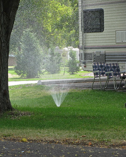 Apparently, this is a thing - campers run sprinklers in their sites