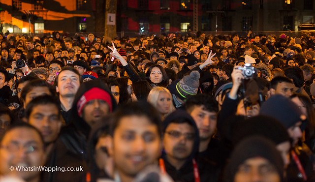 Crowds cheer as they wait for New Year's Eve fireworks