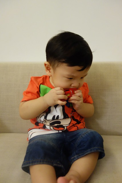 Jerome choo chewing his brother's McQueen toy car