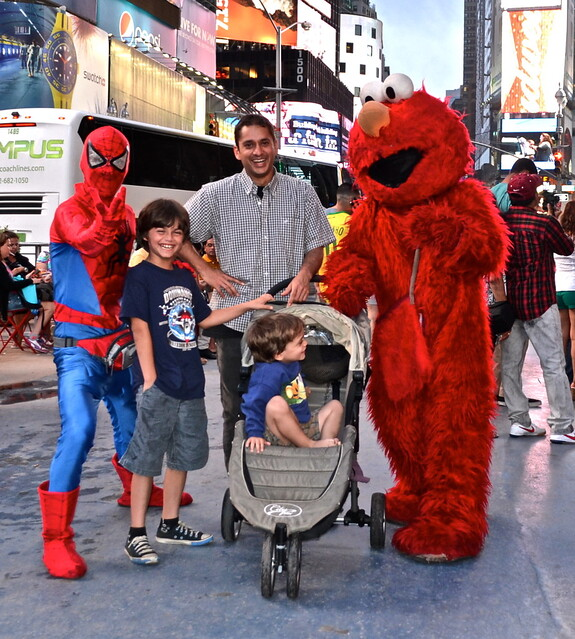 Spiderman, Elmo and the family having fun- Times Square