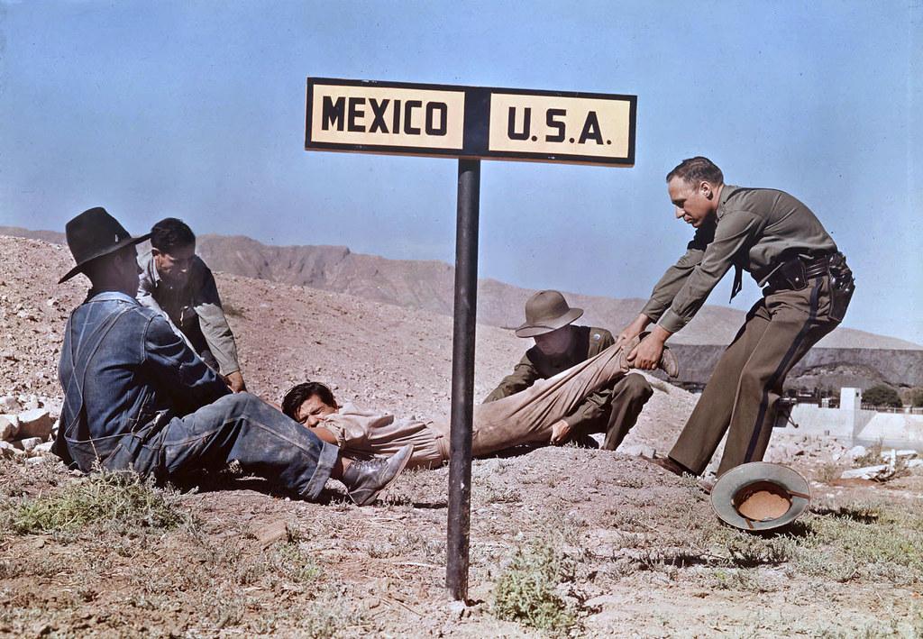 Circa 1939 - Dragging a fugitive across the border, near El Paso, Texas, USA