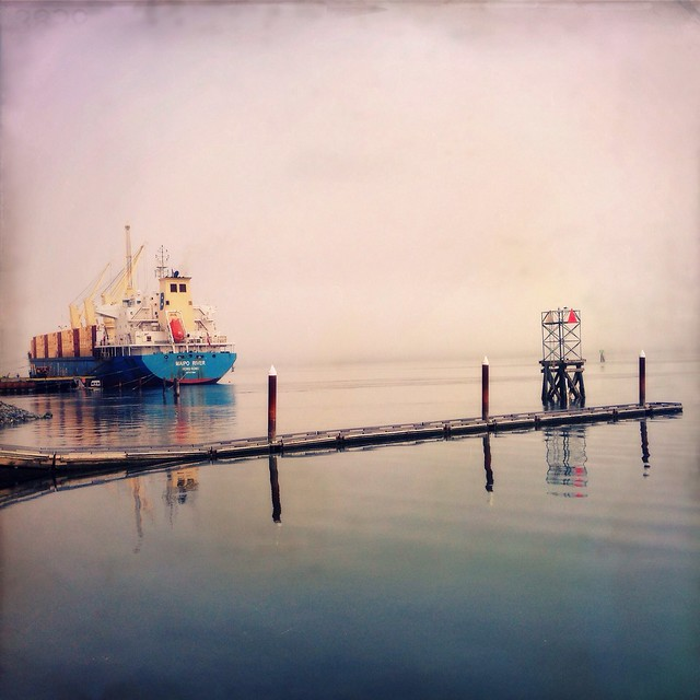 Ship docked at the North Bend waterfront on a foggy day