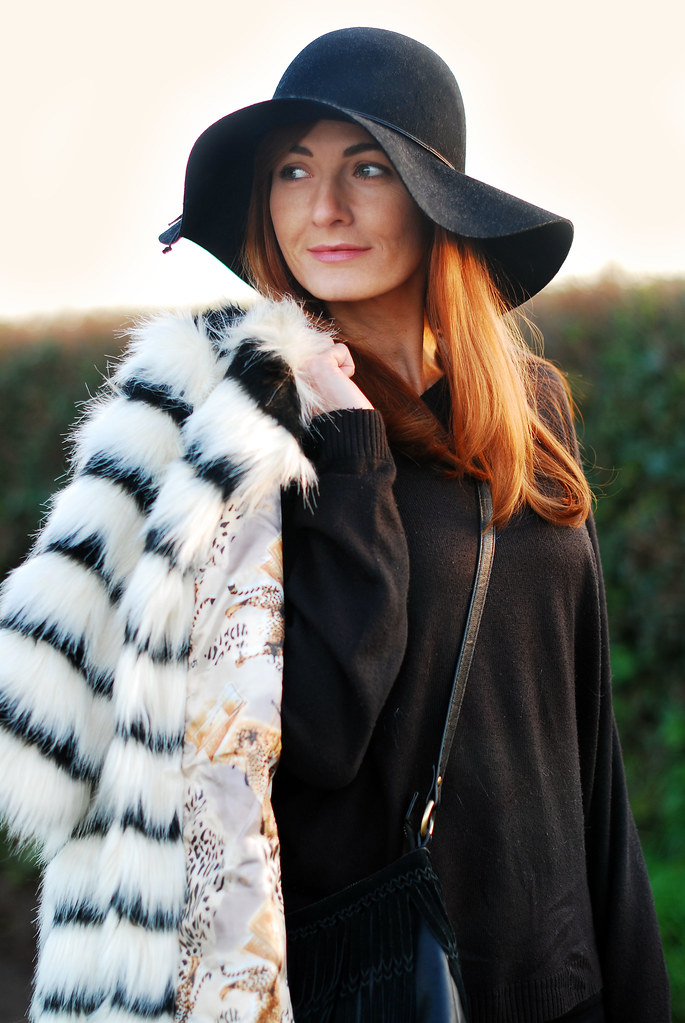 Black & white striped fur coat, black floppy hat