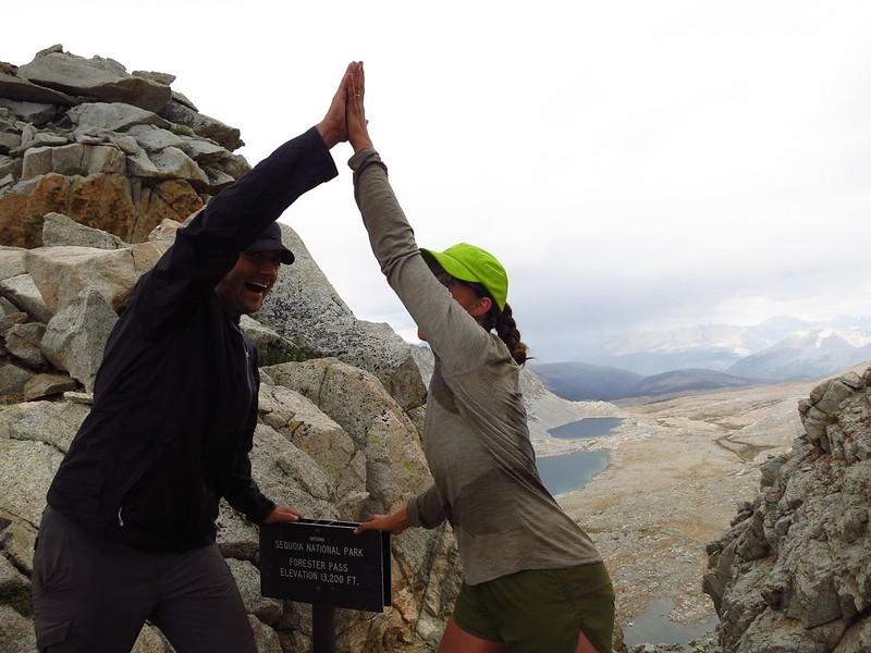 alice and russell high-fiving at forester pass