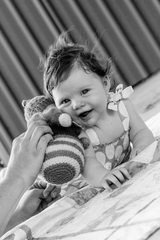 smiling baby with toy