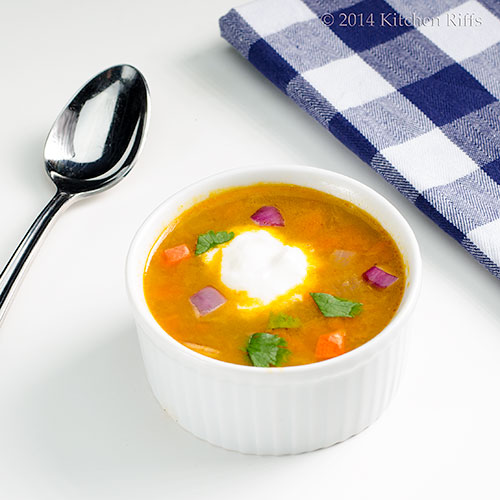 Moroccan Carrot Soup in bowl, with yogurt garnish