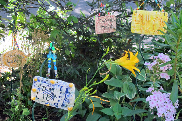 The Lincoln Road R&B Block Association (Lincoln Road between Bedford and Rogers Avenues) created a curbside children's garden with homemade labels. Photo by GreenBridge staff.