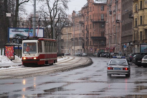 Headed along reserved tracks, ЛМ-99АВ tram number 3311