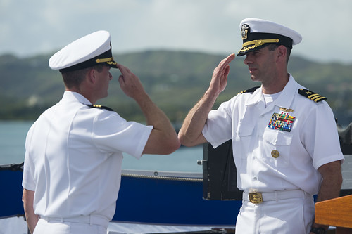 CDR Bob Bryans salutes CDR Kurt Sellerberg, declaring his readiness to relieve him of all duties and responsibilities