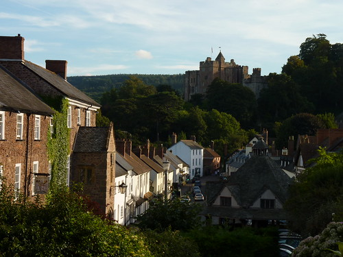 Medieval high street of Dunster, backed by Dunster Castle on the hill