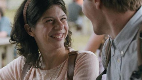 A shot from Gabrielle, featuring the titular character grinning lovingly at her love interest.
