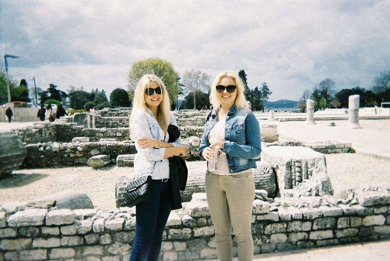 In front of some old Roman ruins