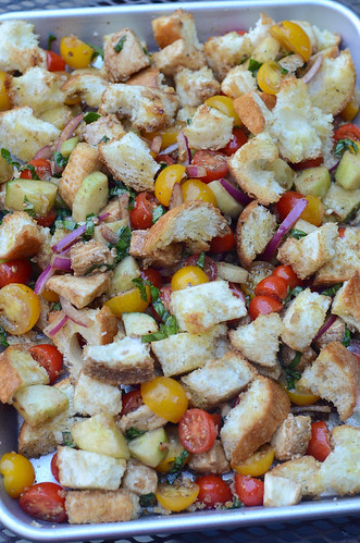 The toasted bread is mixed with the veggies.